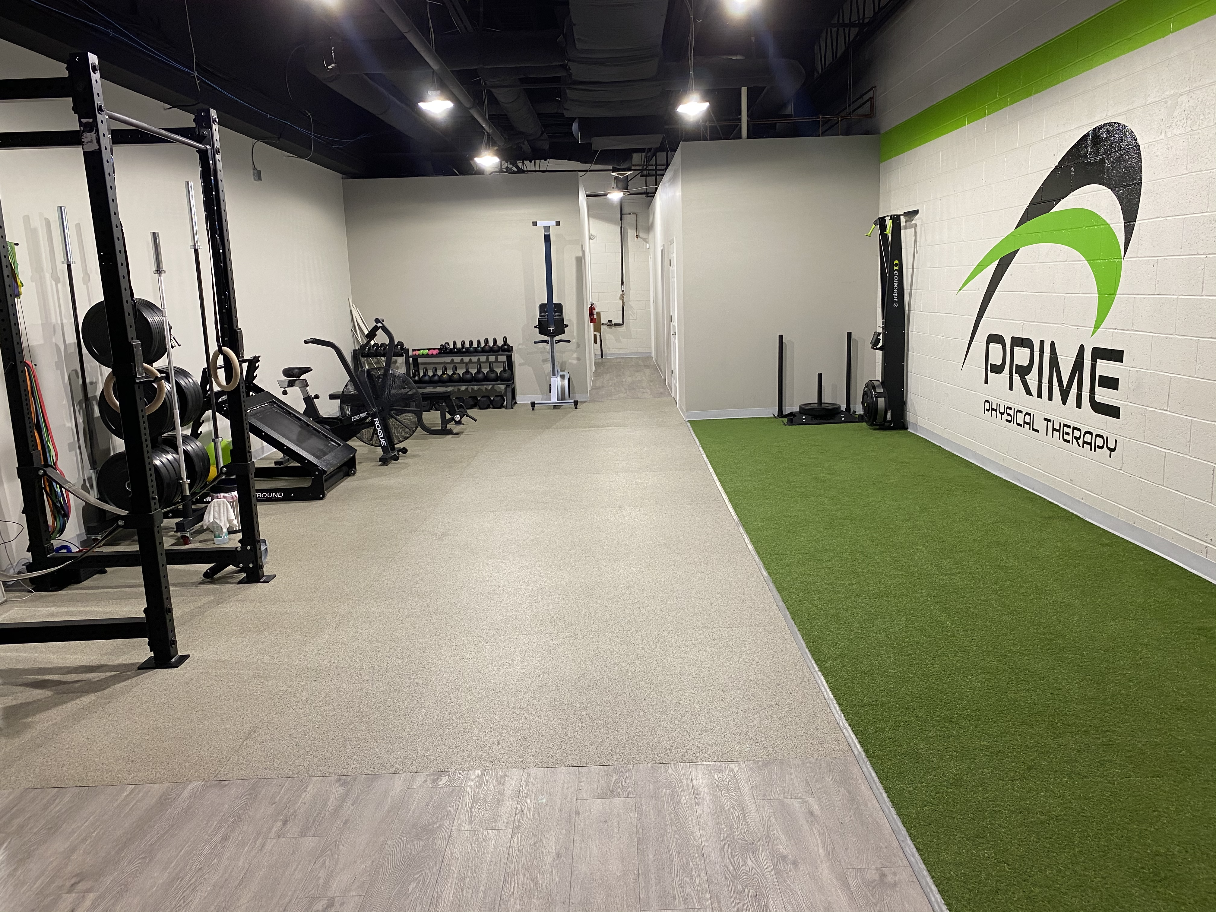PRIME Physical Therapy clinic and gym with fitness equipment, fitness bike, and strength equipment